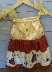This beautiful nutcracker dress is sure to get all kinds of attention and compliments! It is very good for the holidays!!