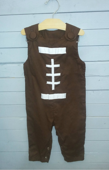 This Jon Jon is designed to look like a football! Great for all season and people who love football! So cute!