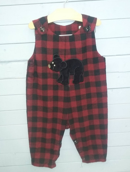 This adorable Jon Jon is made out of red and black buffalo plaid material. It has an appliqued bear on the front and can become even more personalized with a name added. super cute and great for many different occasions.