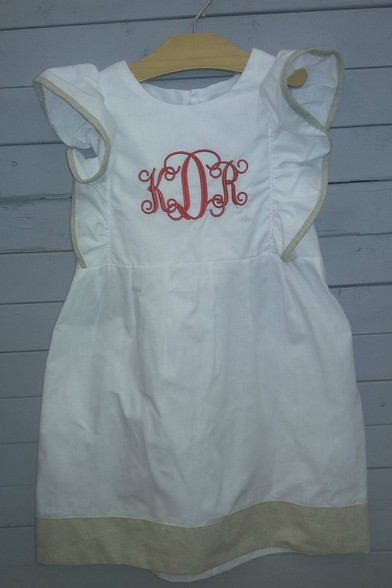 This gorgeous pinafore dress is super delicate! The white goes with the tan so well! You even get the choice of color and initials of monogram. Great for all year long and any occasion!