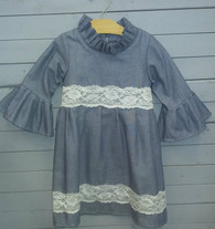 This gorgeous denim dress is an all time top seller. It is a newer style that we have at caught ya lookin' and everybody seems to love it! Can be used in many ways and tons of events. It can be worn with leggings underneath, or a necklace on top. Its so cute that it even looks good the way it is, nothing has to be added to make it look great.