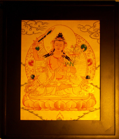 Gold Painting Manjushri Thangka framed.