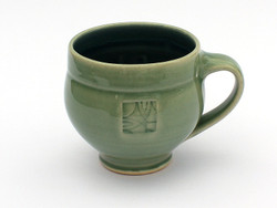Stamped mug in Celadon with blue interior from One Acre Ceramics. Microwave and dishwasher safe. Holds 16 oz. Also available in blue and green.