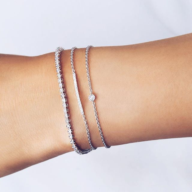 White Gold Arm Candy 1 Carat Diamond Tennis Bracelet Layered With Bar And Pee Solitaire Bracelets