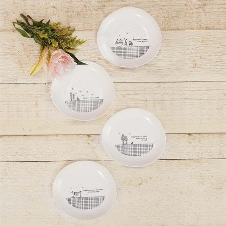 """These small trinket plates are each made of porcelain and feature a sweet phrase on them!  Sayings:   Happiness blooms from within House - love - home Happiness is time spent with a friend Families are the heart of every home Size: 1.25""""h x 4""""d."""