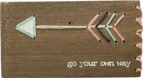 "A wooden block lending a distressed ""Go Your Own Way"" sentiment with hand-stitched feathered arrow accents with single sitched border details.  Contains strong back magnet or can free-stand alone."