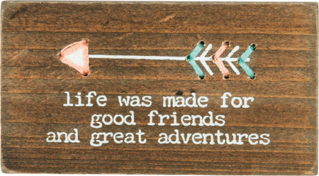 "Wooden block featuring ""Life Was Made For Good Friends And Great Adventures"" sentiment with printed and hand-stitched string arrow design.  Contains strong back magnet or can free-stand alone."