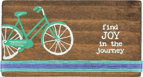 "Wooden block featuring ""Find Joy In The Journey"" sentiment with bike design and layered horizontal hand-stitched string border. Contains strong back magnet or can free-stand alone."