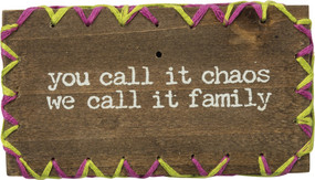 "A wooden block lending a distressed ""You Call It Chaos - We Call It Family"" sentiment with hand-stitched zigzag border details. Contains strong back magnet or can free-stand alone."