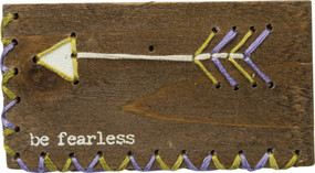 "A wooden block lending a distressed ""Be Fearless"" sentiment with hand-stitched feathered arrow accent and zigzag border details. Contains strong back magnet or can free-stand alone."