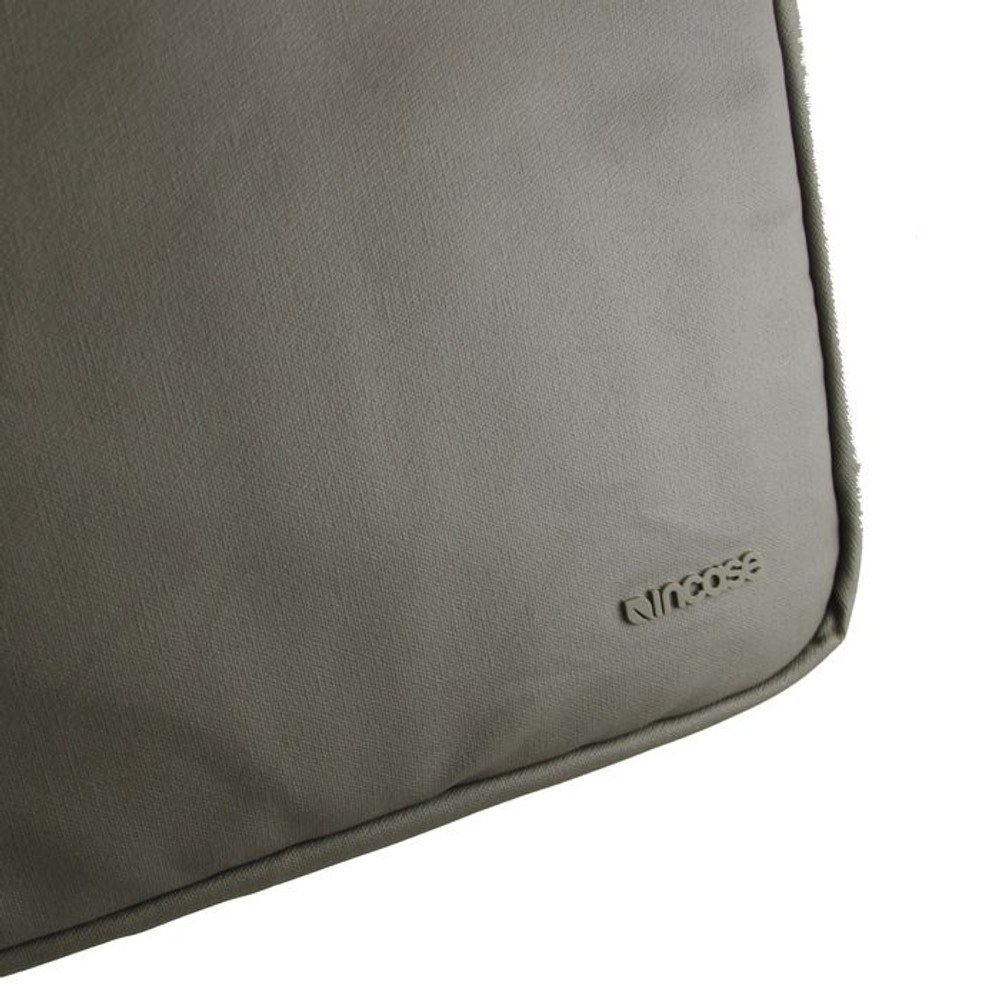 http://d3d71ba2asa5oz.cloudfront.net/12015324/images/cl57688-incase-coated-canvas-sleeve-taupe-detail__56165.jpg