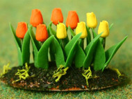 Yellow / Orange Tulips In Earth