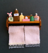 Bathroom Shelf With Accessories & Pink Towels