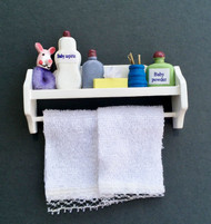 White Bathroom Shelf With Accessories & White Towels