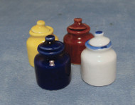 Four Assorted Coloured Storage Jars with Lids