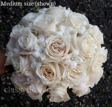 bridal bouquet ivory roses and stephanotis