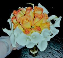 White mini calla lilies bouquet with peach roses