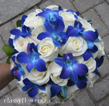 bridal bouquet with white roses and blue dendrobium orchids