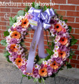Medium size standing wreath with purple roses
