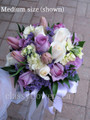 Hand Tied Bridal Bouquet With Roses And Spring Flowers.