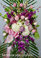 Standing Spray With Purple  Flowers And Orchids