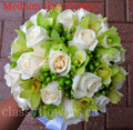 Green Cymbidium Orchids, Green Hypericum Berries and Ivory Roses Bridal Bouquet