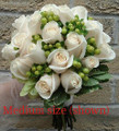 Bridal Bouquet With Ivory Roses And Hypericum Berries