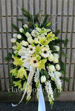 Medium size standing spray with white and cream flowers $125