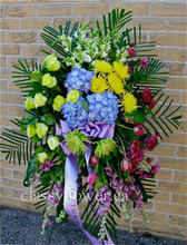 Medium size funeral standing spray with bright flowers $119
