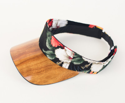 Three quarter view of an aloha fabric visor, black fabric with red flowers