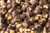 Mother Butter's scratch made Caramel Corn is made in small batches. Then we cover in premium dark chocolate for a sweet and bitter chocolate taste.