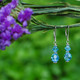 Two Crystal Earrings shown in Sterling Silver Aquamarine.