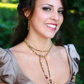 Crystal Lariat in 18k Gold Vermeil Earth. Shown with Crystal Dangle Earrings in Earth.