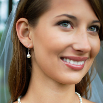 White Single Pearl Earrings in Sterling Silver shown with the Nicole Necklace