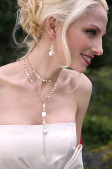 Coin Pearl Lariat shown in 18K Gold Vermeil. Shown with the Coin Pearl Cluster Earrings in 18K Gold Vermeil.