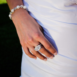 Romance Cluster Ring shown in Sterling Silver. Shown with the Pearl & Clear Bracelet in Sterling Silver.