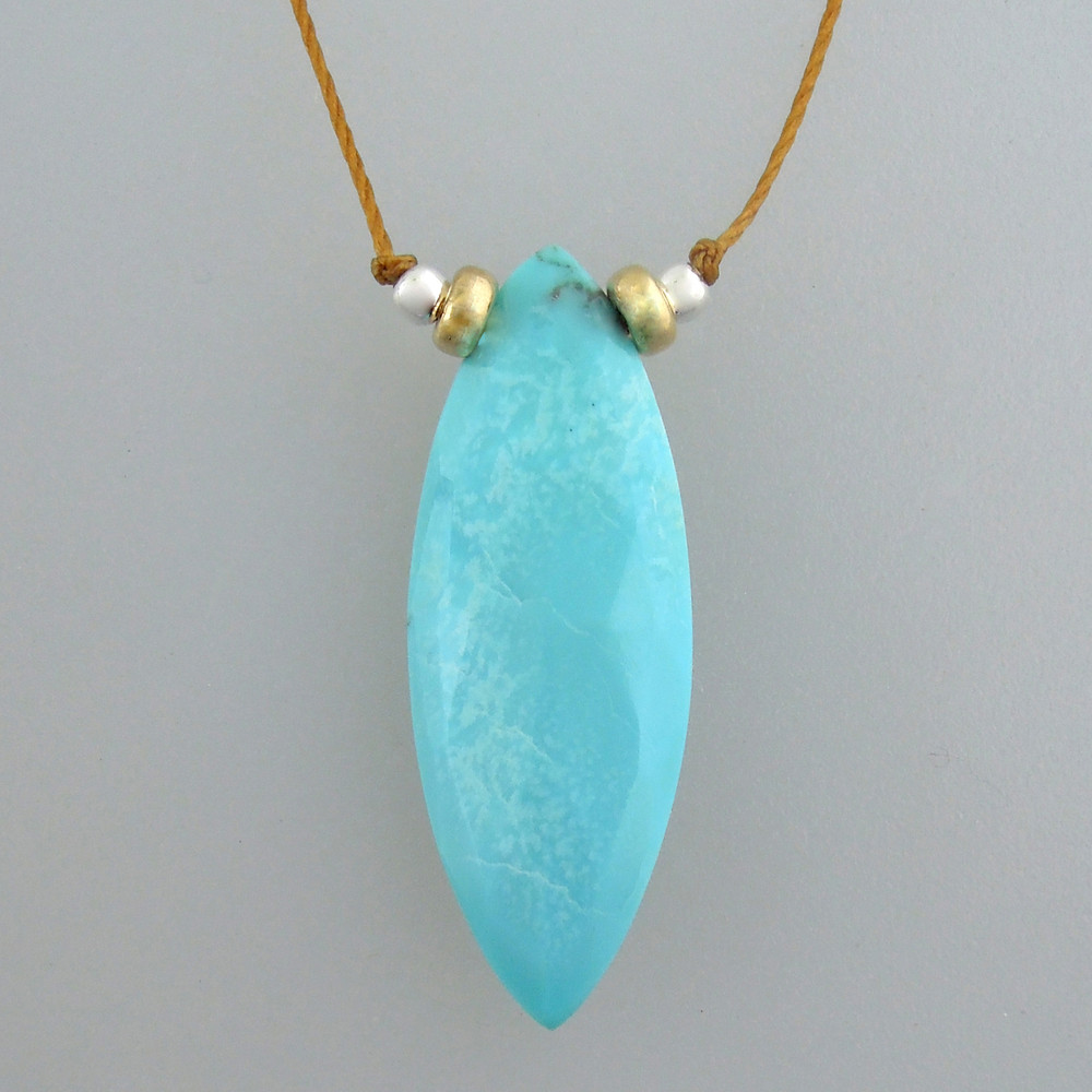 "Marquis cut Arizona turquoise - a smidge over 1"" long"