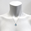 Aquamarine with silver grey cord. 12mm for size reference.