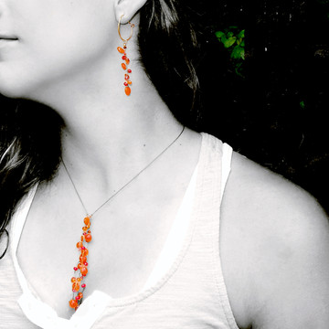 Model is wearing Latham FALL ER Hoops with Mini Milky Way necklace