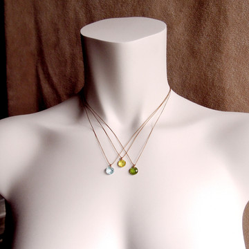 Model is wearing different gems in the same size for reference