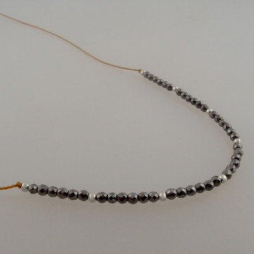 "4"" Halo of micro faceted 2mm (TINY!) hematite on our golden brown bonded microfiber....sterling accents"