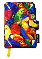 Our Parrot Isle fabric book cover may not be as fanciful as life on a tropical island, but it will add some tropical colors to your life.