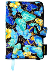 This fabric book cover is all about blue – blues and yellows, and butterflies everywhere! If your eye is drawn to the flutter-by of blue butterflies, you should love this book cover pattern.
