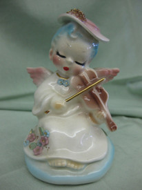 "Sweet little ""Angels Serenade"" is 4"" tall..."
