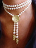"""The Bowl of Diamonds shown here on a pearl lariat with grapes tips.  The lariat is about 48""""  twisted into a choker, and secured with the pearl enhancer.  The lariat can be worn many different ways, and the pearl enhancer can be worn on pearls, beads, ribbons and sometimes a chain if it it thick."""