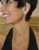 Designer Jane A Gordon wearing the Superstar Fireworks earring and pendant.