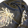 """Silk scarf with Fireworks Superstar pendant as pattern, and the words """"Celebrate Celebrate Celebrate Life is a Celebration"""" repeated in the body of the silk. Shown here closer so you can see the message printed softly and subtly in the silk."""