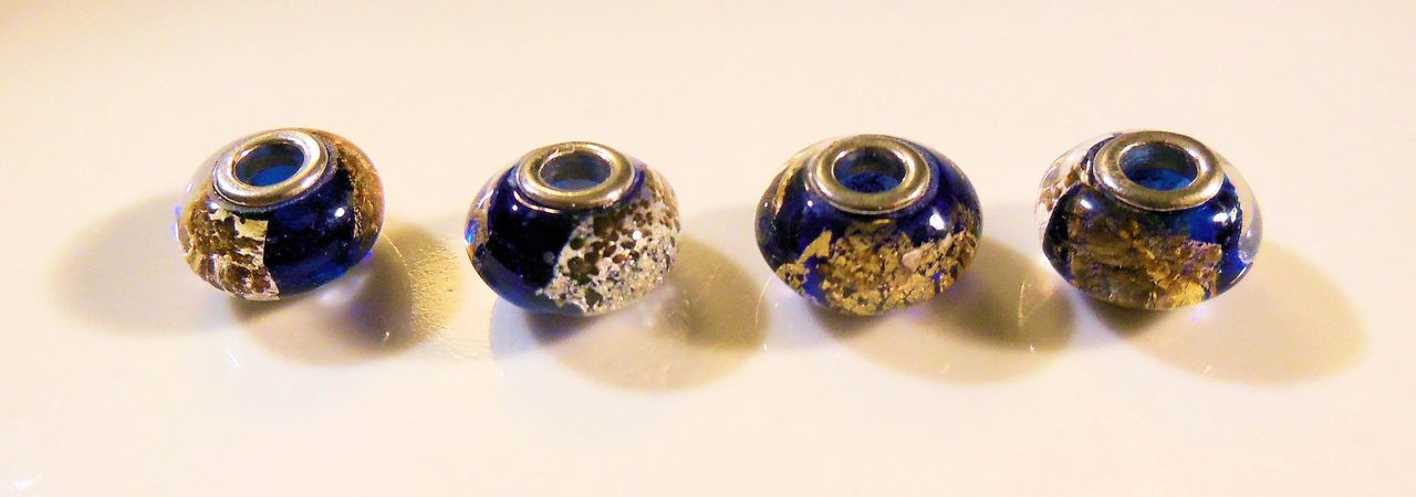 Navy Blue Murano Glass with gold flakes on sterling silver. Fits Pandora.