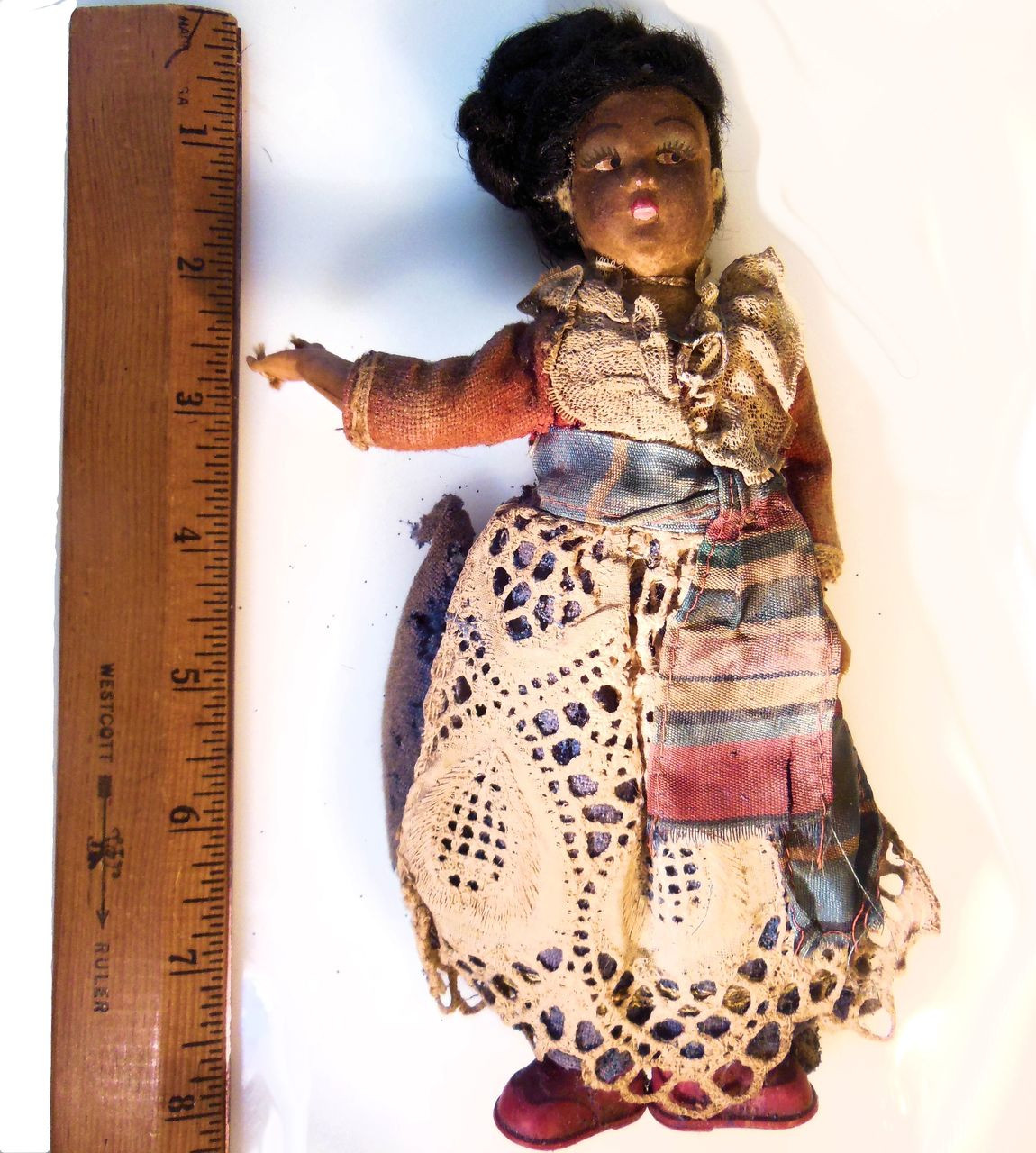 Antique Doll Who Has Seen Better Days