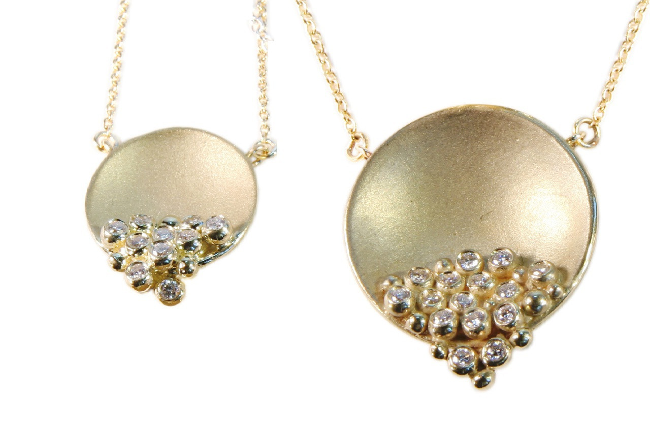 Shown here the Bowl of Diamonds necklaces, gold and diamond necklaces - two sizes in relation to each other.